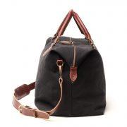 bolsa de viaje negra y asas marrones